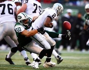 EAST RUTHERFORD, NJ - DECEMBER 31:  Eric Barton #50 of the New York Jets sacks Aaron Brooks #2 of the Oakland Raiders and causes a fumble on December 31, 2006 at Giants Stadium in East Rutherford, New Jersey. The Jets defeated the Raiders 23-3 and clinch