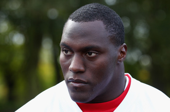 HERTFORD, ENGLAND - OCTOBER 27:  Takeo Spikes of the San Francisco 49ers talks to the media outside The Grove Hotel on October 27, 2010 in Hertford, England. The San Francisco 49ers will meet the Denver Broncos in the NFL International Series regular-seas