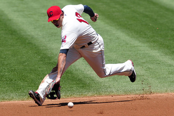 CLEVELAND, OH - JULY 31: Shortstop Asdrubal Cabrera #13 of the Cleveland Indians fields a ground ball during the second inning against the Kansas City Royals at Progressive Field on July 31, 2011 in Cleveland, Ohio. (Photo by Jason Miller/Getty Images)