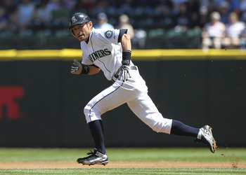 SEATTLE - JULY 30:  Ichiro Suzuki #51 of the Seattle Mariners heads to second on a steal attempt in the first inning against the Tampa Bay Rays at Safeco Field on July 30, 2011 in Seattle, Washington. Dustin Ackley homered on the pitch, and the Mariners w