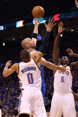 OKLAHOMA CITY, OK - MAY 23:  Jason Kidd #2 of the Dallas Mavericks goes up for a shot over Russell Westbrook #0 and Kendrick Perkins #5 of the Oklahoma City Thunder in the first half in Game Four of the Western Conference Finals during the 2011 NBA Playof