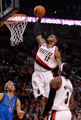 PORTLAND, OR - APRIL 21:  LaMarcus Aldridge #12 of the Portland Trail Blazers dunks against the Dallas Mavericks in Game Three of the Western Conference Quarterfinals in the 2011 NBA Playoffs on April 21, 2011 at the Rose Garden in Portland, Oregon. NOTE