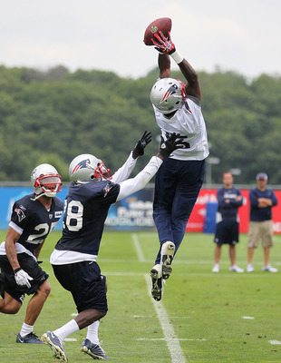 FOXBOROUGH, MA  - JULY 29:  Chad Ochocinco #85 of the New England Patriots catches a pass during the afternoon session of training camp at Gillette Stadium on July 29, 2011 in Foxborough, Massachusetts.  (Photo by Jim Rogash/Getty Images)