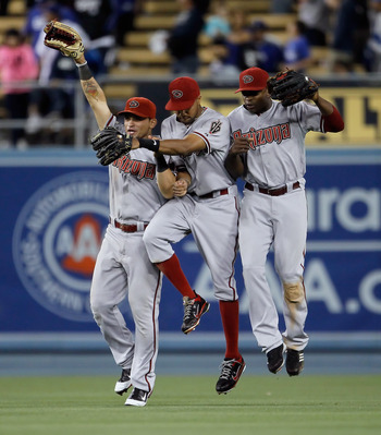 LOS ANGELES, CA - JULY 30:  (L-R) Gerardo Parra #8, Chris Young #24 and Justin Upton #10 of the Arizona Diamondbacks celebrate their teams 6-4 victory over the Los Angeles Dodgers at Dodger Stadium on July 30, 2011 in Los Angeles, California.  (Photo by J