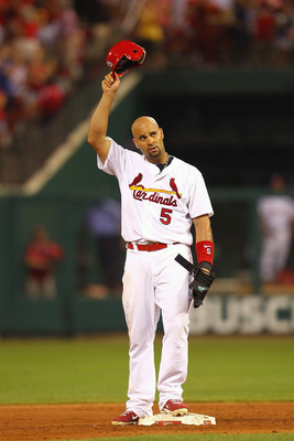 ST. LOUIS, MO - JULY 29: Albert Pujols #5 of the St. Louis Cardinals acknowledges the crowd after collecting his 2,000 career hit, an RBI double against Carlos Marmol #49 of the Chicago Cubs at Busch Stadium on July 29, 2011 in St. Louis, Missouri.  The C