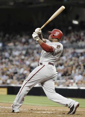 SAN DIEGO, CA - JULY 27: Justin Upton #10 of the Arizona Diamondbacks hits a solo home run during the fourth inning of a baseball game against the San Diego Padres at Petco Park on July 27, 2011 in San Diego, California.  (Photo by Denis Poroy/Getty Image