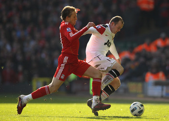 LIVERPOOL, UNITED KINGDOM - MARCH 06:  Wayne Rooney of Manchester United tussles for posession with Lucas of Liverpool during the Barclays Premier League match between Liverpool and Manchester United at Anfield on March 6, 2011 in Liverpool, England. (Pho