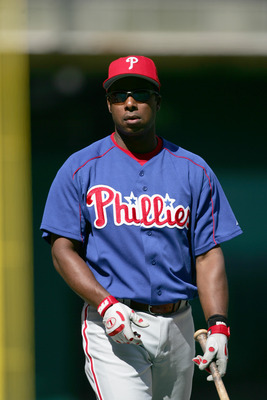 WASHINGTON - APRIL 27:  Designated hitter Jose Offerman #33 of the Philadelphia Phillies warms-up for the game against the Washington Nationals at RFK Stadium on April 27, 2005 in Washington, D.C. The Phillies won 3-0. (Photo by Doug Pensinger/Getty Image