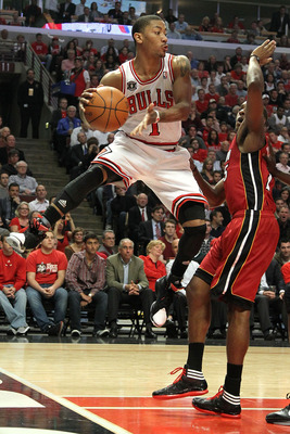 CHICAGO, IL - MAY 26:  Derrick Rose #1 of the Chicago Bulls looks to pass a she drives against Mario Chalmers #15 of the Miami Heat in Game Five of the Eastern Conference Finals during the 2011 NBA Playoffs on May 26, 2011 at the United Center in Chicago,