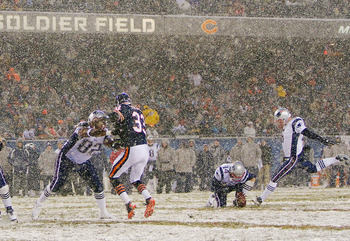 CHICAGO, IL - DECEMBER 12: Shayne Graham #5 of the New England Patriots kicks a field goal against the Chicago Bears at Soldier Field on December 12, 2010 in Chicago, Illinois.  The Patriots beat the Bears 36-7.  (Photo by Dilip Vishwanat/Getty Images)