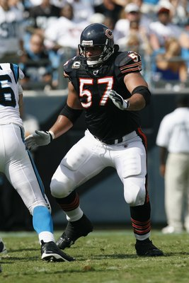 CHARLOTTE, NC - SEPTEMBER 14:  Olin Kreutz #57 of the Chicago Bears blocks during the game against the Carolina Panthers at Bank of America Stadium on September 14, 2008 in Charlotte, North Carolina. (Photo by Kevin C. Cox/Getty Images)
