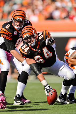 CINCINNATI, OH - OCTOBER 10: Center Kyle Cook #64 points out a blocking assignment against the Tampa Bay Buccaneers at Paul Brown Stadium on October 10, 2010 in Cincinnati, Ohio. (Photo by Jamie Sabau/Getty Images)