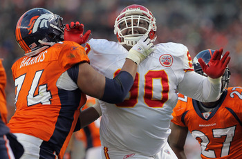 DENVER - NOVEMBER 14:  Defensive tackle Shaun Smith #90 of the Kansas City Chiefs rushes quarterback Kyle Orton against the protection of offensive lineman Ryan Harris #74 of the Denver Bronco at INVESCO Field at Mile High on November 14, 2010 in Denver,