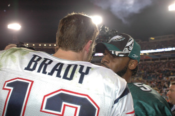 New England Patriots QB Tom Brady #12  talks with Eagles QB # 5 Donovan McNabb after the Patriots defeated the Eagles in Super Bowl XXXIX between the Philadelphia Eagles and the New England Patriots at Alltel Stadium in Jacksonville, Florida on February 6