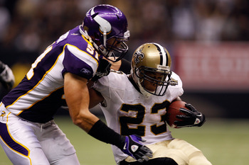 NEW ORLEANS - SEPTEMBER 09:  Pierre Thomas #23 of the New Orleans Saints is hit as he runs the ball by Ben Leber #51 of the Minnesota Vikings at Louisiana Superdome on September 9, 2010 in New Orleans, Louisiana.  (Photo by Chris Graythen/Getty Images)