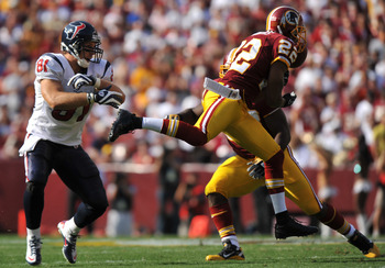 LANDOVER - SEPTEMBER 19:  Carlos Rogers #22 of the Washington Redskins makes an interception against the Houston Texans at FedExField on September 19, 2010 in Landover, Maryland. The Texans defeated the Redskins 30-27 in overtime. (Photo by Larry French/G