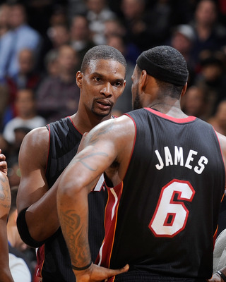 WASHINGTON, DC - DECEMBER 18:  Chris Bosh #1 of the Miami Heat talks with LeBron James #6 and Mario Chalmers #15 during the game against the Washington Wizards at the Verizon Center on December 18, 2010 in Washington, DC. NOTE TO USER: User expressly ackn