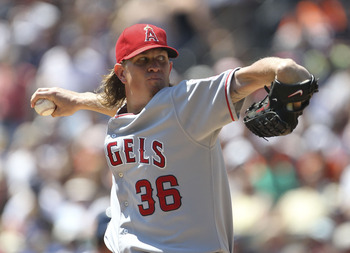 DETROIT - JULY 31:  Jered Weaver #36 of the  Los Angeles Angels of Anaheim pitches in the second inning during the game against the Detroit Tigers at Comerica Park on July 31, 2011 in Detroit, Michigan.  (Photo by Leon Halip/Getty Images)