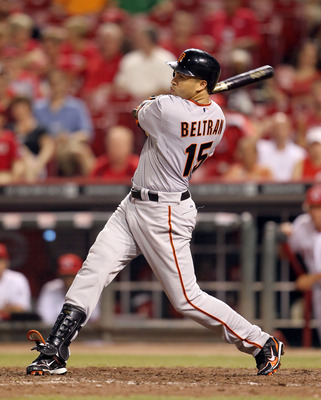 CINCINNATI, OH - JULY 30:  Carlos Beltran #15 of the San Francisco hits a pitch during the game against the Cincinnati Reds at Great American Ball Park on July 30, 2011 in Cincinnati, Ohio.  (Photo by Andy Lyons/Getty Images)
