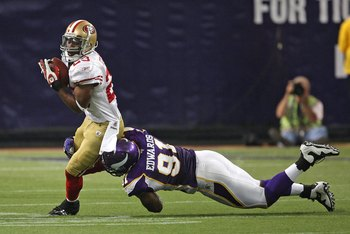 MINNEAPOLIS - SEPTEMBER 27: Marcus Hudson #23 of the San Francisco 49ers is tackled by Ray Edwards #91 of the Minnesota Vikings at the Hubert H. Humphrey Metrodome on September 27, 2009 in Minneapolis, Minnesota. The Vikings defeated the 49ers 27-24. (Pho
