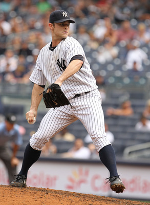 NEW YORK, NY - JULY 24:  David Robertson #30 of the New York Yankees pitches to the Oakland Athletics during their game on July 24, 2011 at Yankee Stadium in the Bronx borough of New York City.  (Photo by Al Bello/Getty Images)