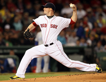 BOSTON, MA - JULY 25:  Jon Lester #31 of the Boston Red Sox delivers a pitch in the first inning against the Kansas City Royals on July 25, 2011 at Fenway Park in Boston, Massachusetts.  (Photo by Elsa/Getty Images)