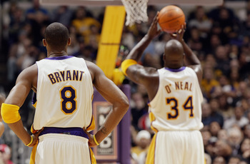 LOS ANGELES - NOVEMBER 30:  Kobe Bryant #8 of the Los Angeles Lakers watches teammate Shaquille O'Neal #34 shoot a free throw during the game against the Indiana Pacers at Staples Center on November 30, 2003 in Los Angeles, California.  The Lakers won 99-