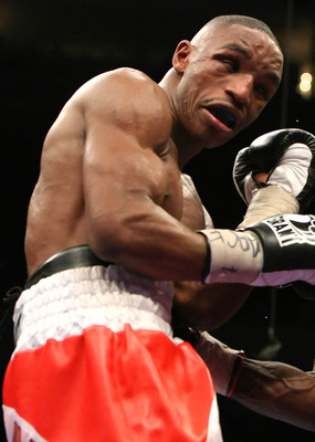 NEW YORK - JANUARY 19:  DeMarcus Corley (R) lands a body punch against Devon Alexander (L) during their WBC Continental Super Welterweight Championship bout at Madison Square Garden January 19, 2008 in New York City.  (Photo by Al Bello/Getty Images)