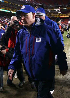LANDOVER, MD - JANUARY 02:  Head coach Tom Coughlin of the New York Giants walks off the field after defeating the Washington Redskins at FedEx Field on January 2, 2011 in Landover, Maryland. The Giants won the game 17-14.  (Photo by Win McNamee/Getty Ima