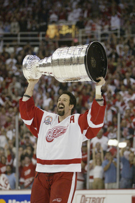 DETROIT, MI - JUNE 13:  Brendan Shanahan of the Detroit Red Wings raises the Stanley Cup after eliminating the Carolina Hurricanes during game five of the NHL Stanley Cup Finals on June 13, 2002 at the Joe Louis Arena in Detroit, Michigan.  The Red Wings