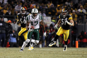 PITTSBURGH, PA - JANUARY 23:  Braylon Edwards #17 of the New York Jets runs for yards after the catch against the Pittsburgh Steelers during the 2011 AFC Championship game at Heinz Field on January 23, 2011 in Pittsburgh, Pennsylvania. The Steelers won 24