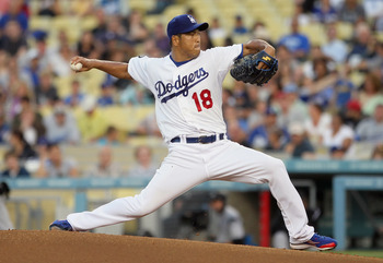 LOS ANGELES, CA - JULY 27:  Hiroki Kuroda #18 of the Los Angeles Dodgers pitches against the Colorado Rockies in the second inning at Dodger Stadium on July 27, 2011 in Los Angeles, California.  (Photo by Jeff Gross/Getty Images)