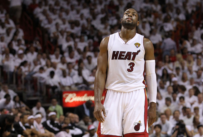 MIAMI, FL - JUNE 12:  Dwyane Wade #3 of the Miami Heat reacts while taking on the Dallas Mavericks in Game Six of the 2011 NBA Finals at American Airlines Arena on June 12, 2011 in Miami, Florida. NOTE TO USER: User expressly acknowledges and agrees that,