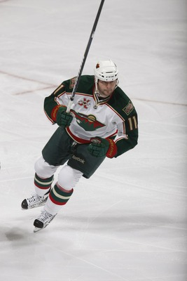 EDMONTON, CANADA - JANUARY 18: John Madden #11 of the Minnesota Wild skates against the Edmonton Oilers on January 18, 2011 at Rexall Place in Edmonton, Alberta, Canada. (Photo by Dale MacMillan/Getty Images)