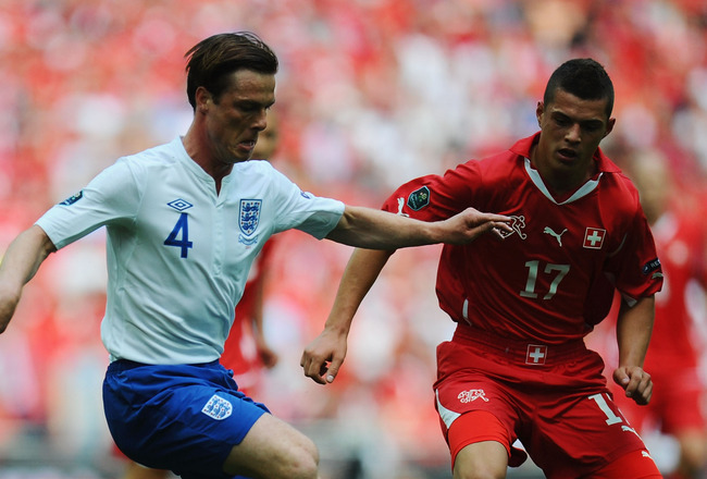 LONDON, ENGLAND - JUNE 04: Scott Parker of England (L) in action against Granit Xhaka of Switzerland during the UEFA EURO 2012 group G qualifying match between England and Switzerland at Wembley Stadium on June 4, 2011 in London, England.  (Photo by Clive