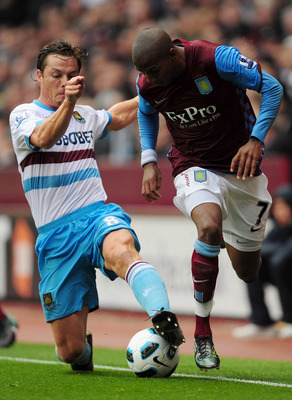 BIRMINGHAM, ENGLAND - AUGUST 14:  Ashley Young of Aston Villa battles with Scott Parker of West Ham United during the Barclays Premier League match between Aston Villa and West Ham United at Villa Park on August 14, 2010 in Birmingham, England.  (Photo by