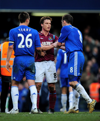 LONDON, ENGLAND - MARCH 13:  Scott Parker of West Ham shakes hands with John Terry (L) and Frank Lampard (R) of Chelsea following the final whistle during the Barclays Premier League match between Chelsea and West Ham United at Stamford Bridge on March 13