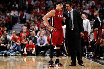 CHICAGO, IL - MAY 18:  (L-R) Mike Bibby #0 and head coach Erik Spoelstra of the Miami Heat against the Chicago Bulls in Game Two of the Eastern Conference Finals during the 2011 NBA Playoffs on May 18, 2011 at the United Center in Chicago, Illinois. The H
