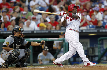 PHILADELPHIA - JULY 30:  Jimmy Rollins #11 of the Philadelphia Phillies hits a home run in front of Michael McHenry #55 of the Pittsburgh Pirates at Citizens Bank Park on July 30, 2011 in Philadelphia, Pennsylvania.  (Photo by Jeff Zelevansky/Getty Images