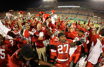 ORLANDO, FL - DECEMBER 28:  North Carolina State Wolfpack head coach Tom O'Brien celebrates after winning  the Champs Sports Bowl against the West Virginia Mountineers at Florida Citrus Bowl Stadium on December 28, 2010 in Orlando, Florida.  (Photo by Mik