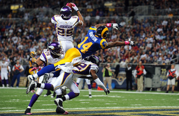 ST. LOUIS - OCTOBER 11:  Safety Tyrell Johnson #25 of the Minnesota Vikings makes a pass interception inteded for Keenan Burton #14 of the St. Louis Rams at Edward Jones Dome on October 11, 2009 in St. Louis, Missouri.  (Photo by Ronald Martinez/Getty Ima