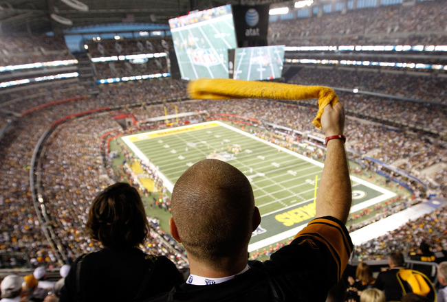ARLINGTON, TX - FEBRUARY 06:  A Steelers' fan watches the Green Bay Packers take on the Pittsburgh Steelers in Super Bowl XLV at Cowboys Stadium on February 6, 2011 in Arlington, Texas.  (Photo by Tom Pennington/Getty Images)