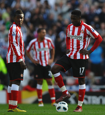 SUNDERLAND, ENGLAND - APRIL 09: Danny Welbeck and Asmoah Gyan of Sunderland show their dissapointment during the Barclays Premier League match between Sunderland and West Bromwich Albion at The Stadium of Light on April 9, 2011 in Sunderland, England.  (P