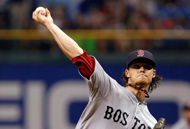 ST PETERSBURG, FL - JUNE 16:  Pitcher Clay Buchholz #11 of the Boston Red Sox pitches against the Tampa Bay Rays during the game at Tropicana Field on June 16, 2011 in St. Petersburg, Florida.  (Photo by J. Meric/Getty Images)