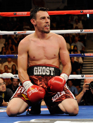LAS VEGAS - JULY 31:  Robert Guerrero kneels on the canvas after being hit by Joel Casamayor in the 10th round of their junior welterweight fight at the Mandalay Bay Events Center July 31, 2010 in Las Vegas, Nevada. Guerrero won by unanimous decision.  (P