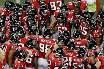 ATLANTA, GA - JANUARY 15:  Mike Peterson #53 of the Atlanta Falcons leads his team in a pregame huddle against the Green Bay Packers during their 2011 NFC divisional playoff game at Georgia Dome on January 15, 2011 in Atlanta, Georgia.  (Photo by Kevin C.