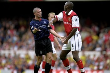 Captain Keane in blue gets into the usual spat with Arsenals skipper.