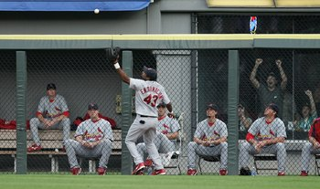 CHICAGO - JUNE 21:  Right fielder Juan Encarnacion #43 of the St. Louis Cardinals tries to play a ball in front of the Cardinal bullpen hit by Jim Thome #25 of the Chicago White Sox (not shown) for a double in the 1st inning on June 21, 2006 at U.S. Cellu