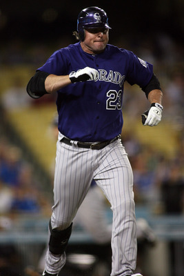 LOS ANGELES, CA - JULY 25:  Jason Giambi #23 of the Colorado Rockies pulls up injured as he runs to first base reaching safely on a throwing error to load the bases against the Los Angeles Dodgers in the ninth inning of the game at Dodger Stadium on July
