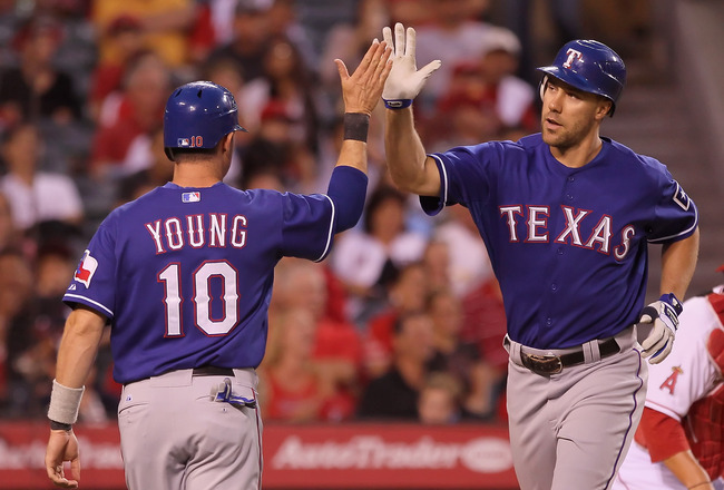 ANAHEIM, CA - JULY 20:  David Murphy (R) #7 of the Texas Rangers is congratulated by Michael Young #10 after hitting a two-run home run against the Los Angeles Angels of Anaheim in the fourth inning at Angel Stadium of Anaheim on July 20, 2011 in Anaheim,